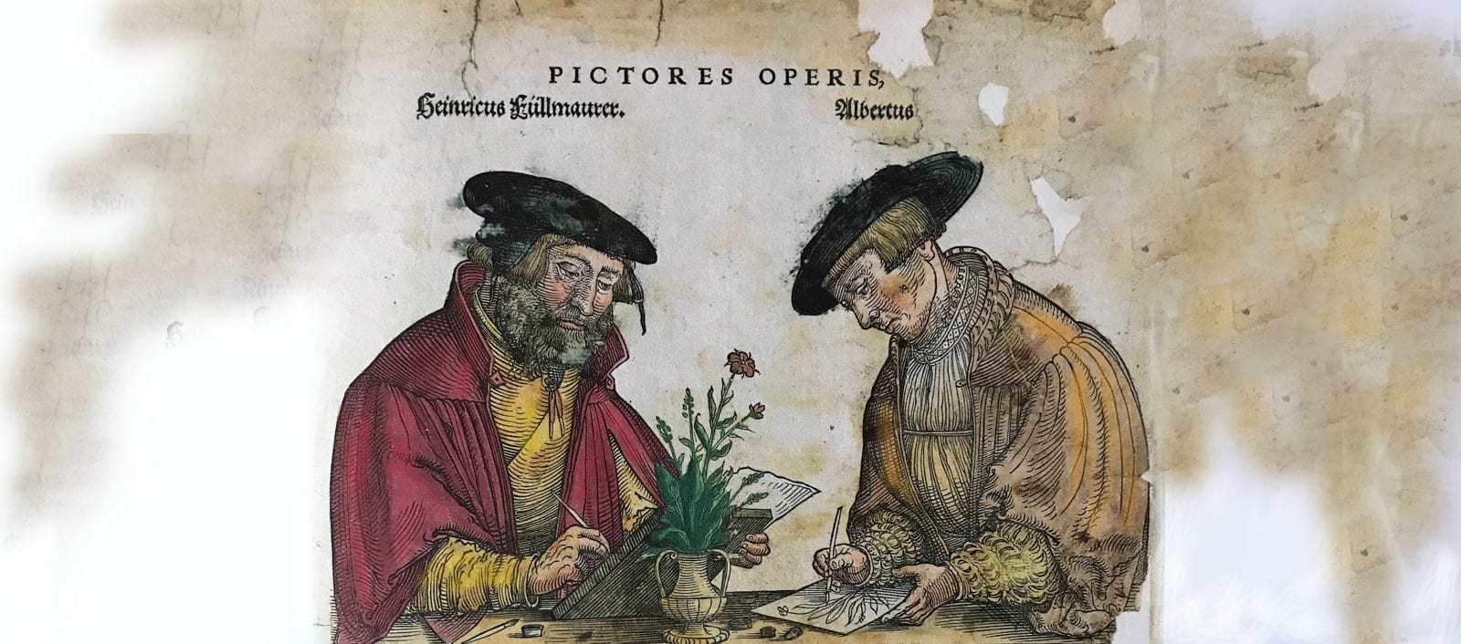 Due persone che parlano disegnando